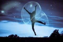 Silhouet Gelukkige Jongen die binnen een Grote Bel springen Royalty-vrije Stock Fotografie