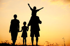 Silhouet, gelukkige kinderen met moeder en vader Royalty-vrije Stock Foto's