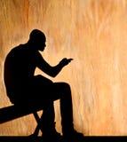 Silhouet gezette persoon Royalty-vrije Stock Afbeelding