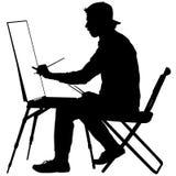Silhouet, kunstenaar op het werk aangaande een witte achtergrond, Royalty-vrije Stock Afbeelding