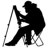 Silhouet, kunstenaar op het werk aangaande een witte achtergrond, Stock Afbeeldingen