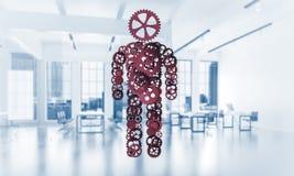Silhouet of ontwerp van de mens als één werkend mechanisme a wordt voorgesteld die Stock Afbeeldingen