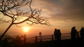 Silhouet and sunshine is morning. People in the mountain take a clean air Royalty Free Stock Images
