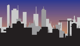 Silhouet van abstracte stad bij zonsondergang Stock Foto