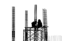 Silhouet van bouwvakkers Stock Foto