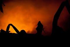 Silhouet van Brandweerlieden Stock Foto