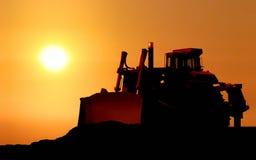 Silhouet van de bulldozer stock afbeeldingen