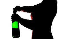 Silhouet van de vrouw het openen champagne Royalty-vrije Stock Fotografie