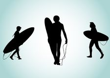 Silhouet van drie surfers Royalty-vrije Stock Foto's