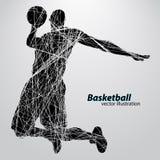 Silhouet van een basketbalspeler Stock Fotografie