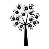 Silhouet van een boom met handprints Stock Afbeeldingen