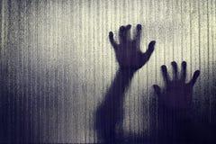 Silhouet van een hand de gevangen te nemen uitdrukking, onduidelijk beeld Stock Foto's