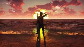 Silhouet van een jonge mannelijke surfer die zich op het strand bij zonsopgang met een surfplank bevinden en op de oceaangolven l stock foto