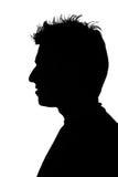 Silhouet van een jonge mens stock afbeeldingen
