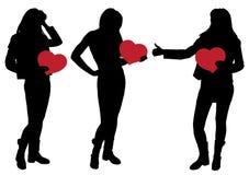 Silhouet van een Meisje die een Hart houden Stock Fotografie