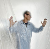 Silhouet van een mens achter plastiek Royalty-vrije Stock Afbeelding