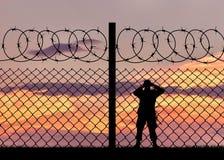 Silhouet van een militaire grenswacht royalty-vrije stock afbeelding