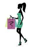 Silhouet van een modieuze winkelende vrouw Stock Foto's