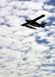 Silhouet van een overzees vliegtuig Stock Fotografie
