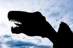 Silhouet van een reuzegrootte Spinosaurus Royalty-vrije Stock Foto's