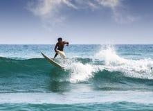 Silhouet van een surfer Stock Foto