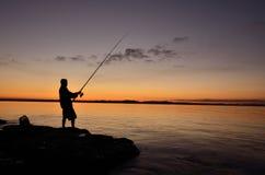 Silhouet van een visser Stock Fotografie
