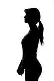 silhouet van een vrouwelijk cijfer aangaande een witte achtergrond Stock Foto's