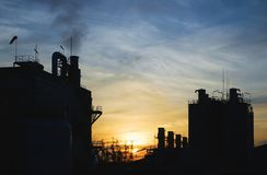 Silhouet van fabriek Stock Foto