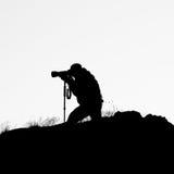 Silhouet van fotograaf Stock Foto's