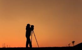 Silhouet van fotograaf Stock Afbeelding