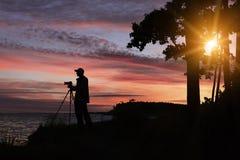 Silhouet van fotograaf Stock Afbeeldingen