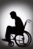 Silhouet van Gehandicapt Person In Wheelchair Stock Afbeelding