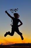 Silhouet van gelukkig kind royalty-vrije stock fotografie