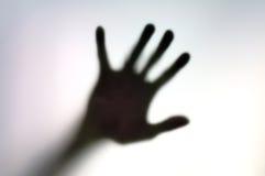 Silhouet van hand op een witte oppervlakte Royalty-vrije Stock Afbeeldingen