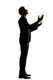 Silhouet van het Aziatische zakenman bidden Royalty-vrije Stock Fotografie
