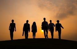 Silhouet van het Bedrijfsmensen Lopen Stock Foto