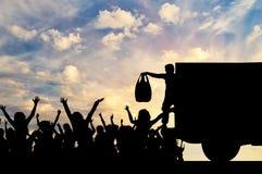 Silhouet van humanitaire hulp aan de vluchtelingen royalty-vrije stock afbeeldingen