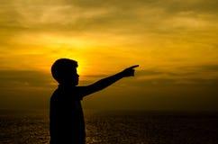 Silhouet van jongen stock afbeeldingen
