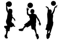 Silhouet van jongens speelbasketbal Stock Foto's