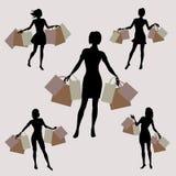 Silhouet van meisjes met het winkelen Stock Afbeeldingen