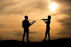 Silhouet van musicus royalty-vrije stock foto's