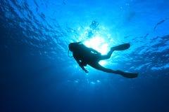 Silhouet van scuba-duiker Stock Foto