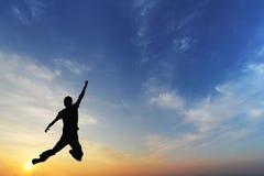 Silhouet van springend mensen Bedrijfsconcept Royalty-vrije Stock Fotografie