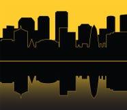 Silhouet van stad op gele achtergrond Royalty-vrije Stock Afbeeldingen