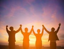 Silhouet van succes commercieel teamconcept stock foto