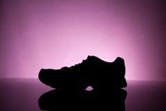 Silhouet van Tennisschoenen Stock Foto's