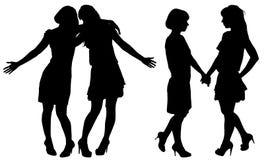 Silhouet van twee jonge slanke vrouwen Stock Afbeeldingen