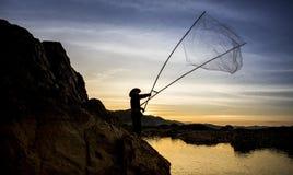 Silhouet van vissers Stock Afbeelding