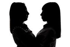 Silhouet van vrouwen die elkaar bekijken Royalty-vrije Stock Fotografie