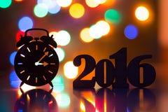 Silhouet van wekker en inschrijving van het jaar van 2016 Royalty-vrije Stock Fotografie